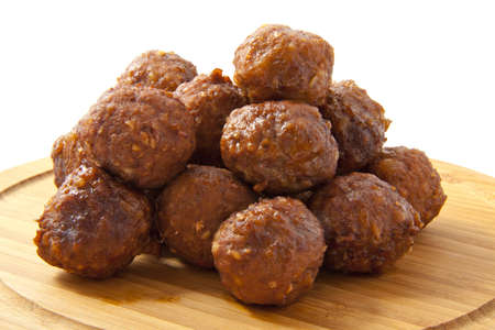Meatballs on a wooden plate on a white background Stock Photo