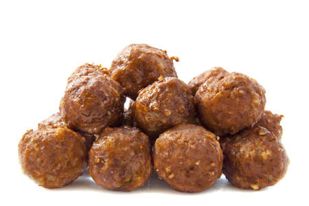 A pile of meatballs isolated over white photo