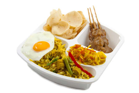 Take away meal with indonesian food isolated over white