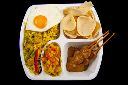 Indonesian take away meal isolated over black Stockfoto