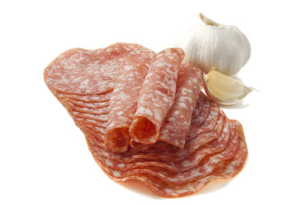 dinne: Salami on a pile with garlic isolated on a white background Stock Photo