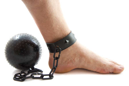 Chained foot with ball isolated over white photo