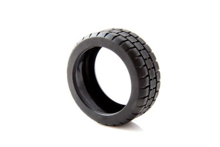 Black car tire isolated on a white background photo