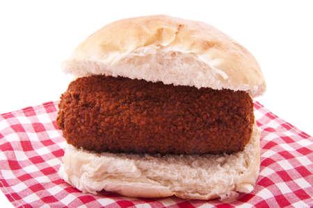 pollo rostizado: Pan con carne crujiente holand�s en una servilleta para el uso del fondo