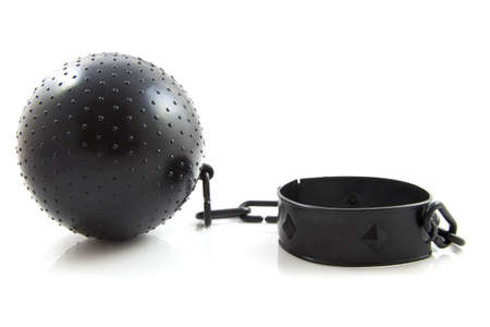 Black ball with chain isolated over white photo