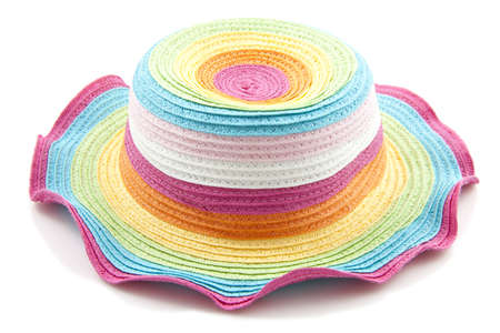 Colorful rainbow straw hat close up over white photo