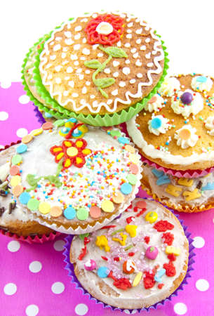 Colorful decorated delicious cup cakes for background use photo