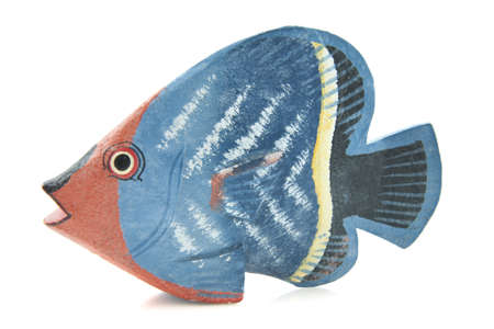 toy fish: Colorful wooden painted fish on a white background