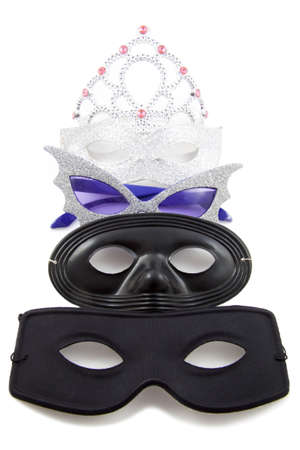 Four decorative masks in a row over white Stock Photo - 12807113