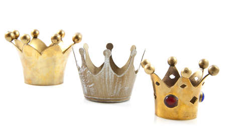Three golden crowns in a row over white
