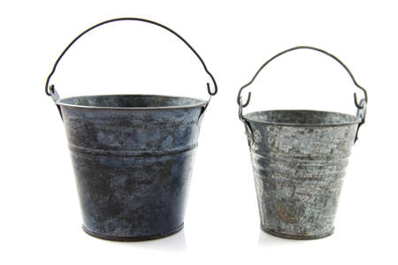 Two old metal vintage buckets isolated over white photo
