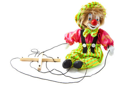 Fancy happy marionette puppet on a white background photo