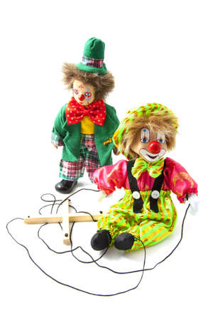 puppet theatre: One clown and one marionette puppet over white Stock Photo