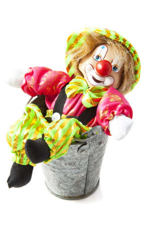 Happy clown in zinc bucket isolated over white photo