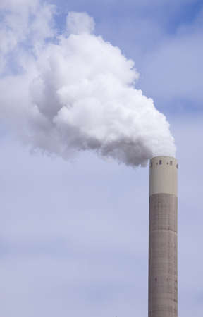 deleterious: Big large chimney with a lot of smoke in front of a cloudy sky
