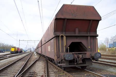 Old rusty cargo train closeup on the railroad