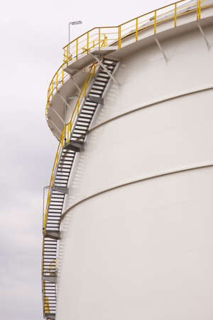 Big oil tank with staircase close up photo