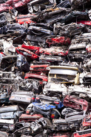 Lots of old cars on a pile for scrapuse