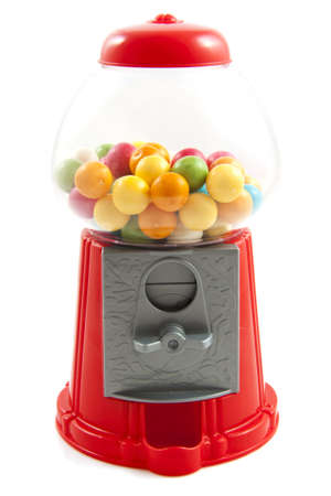 Colorful gumballs in gumball machine isolated over white photo