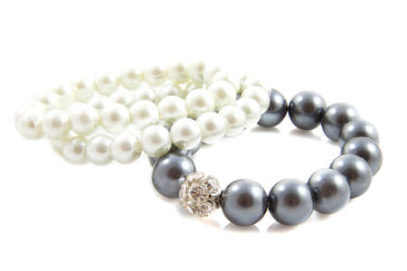 Beautiful bracelet with pearls  isolated over white photo