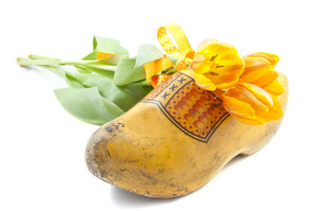 clog: Dutch wooden shoe with dutch orange tulips over white