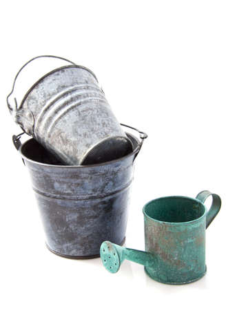 Vintage watering can and old bucket isolated over white photo