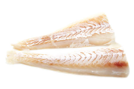 cod: Two alaska cod filliets isolated on a white background Stock Photo