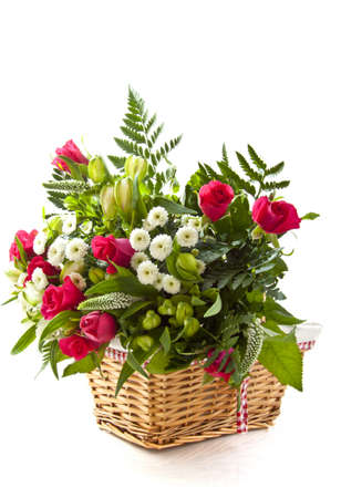 mariage: Bouquet with different kind of flowers in wooden basket over white