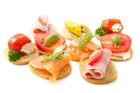 tapas: Toast with good food isolated over white