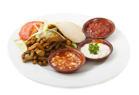 yiddish: Pita filled with shoarma on a plate isolated over white