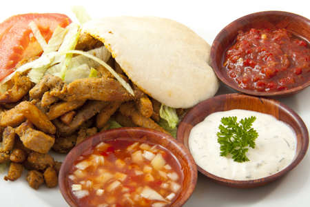 Pita filled with shoarma on a plate with sauce Stock Photo
