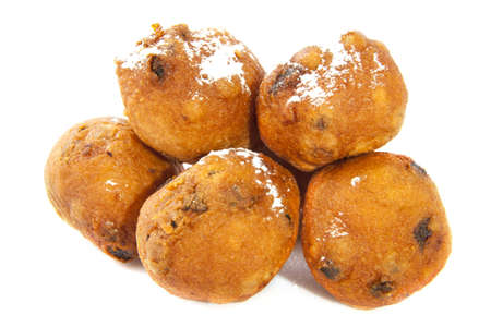 Traditional dutch oliebollen with sugar isolated over white photo