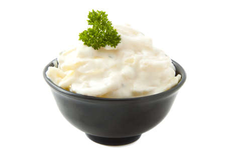 German potato salad in bowl isolated over white photo