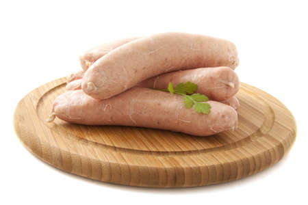 comestible: Fresh sausage on a wooden plate with white background