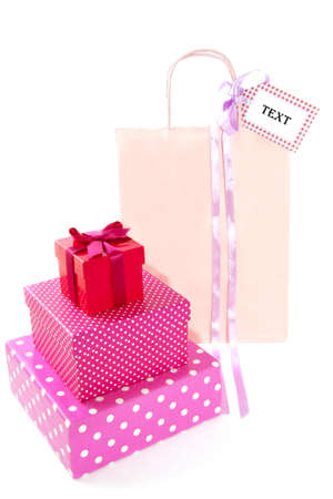 shoppingbag: Colorful speckled giftboxes with pink shoppingbag isolated over white