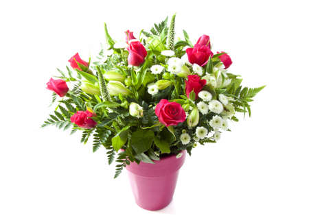 Bouquet with colorful flowers in a pink vase isolated over white