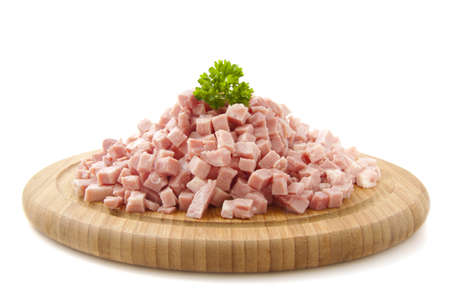 Pieces of ham on wooden plate isolated over white