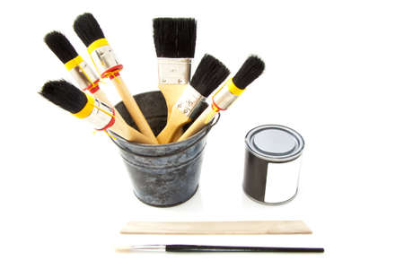 Paintbrushes in tin bucket with paint-pot isolated over white Stock Photo - 15163261