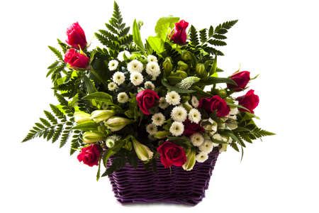 Bouquet with pink roses in purple basket isolated over white