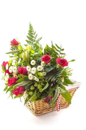 mariage: Beautiful bouquet in wooden basket isolated over white
