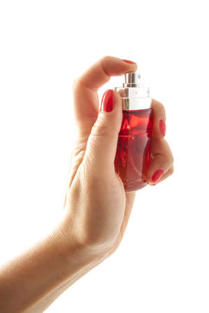 parfum: Female hand with red parfum bottle over white Stock Photo