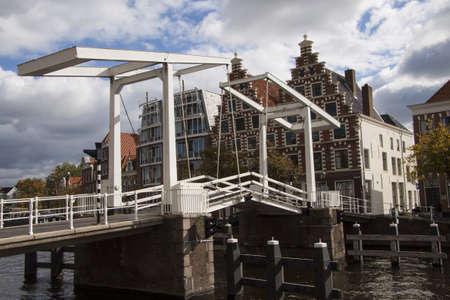 gabled house: Bicycle bridge in haarlem with cloudy skies