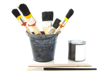 paintcan: Bucket with paintbrushes and paint-can on the side isolated over white Stock Photo