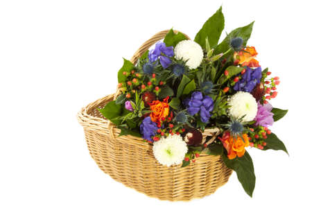 Basket filled with flowers isolated over white photo