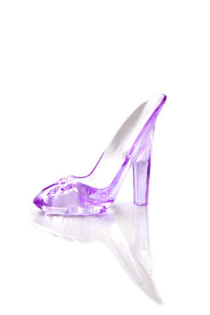 slipper: Beautiful pink glass high-heeled shoe isolated over white Stock Photo