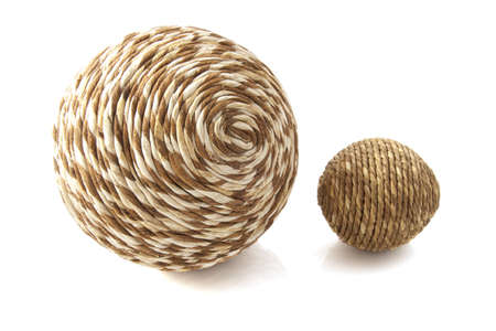 weave ball: Two wooden twisted simple balls isolated over white