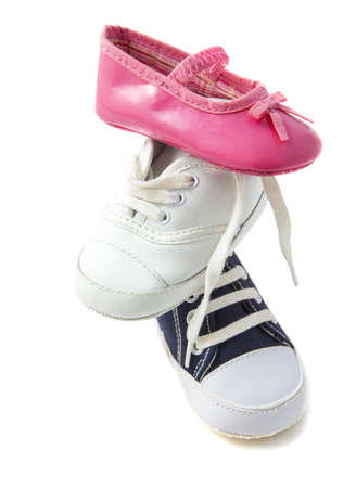 Baby shoes on a pile isolated over white photo