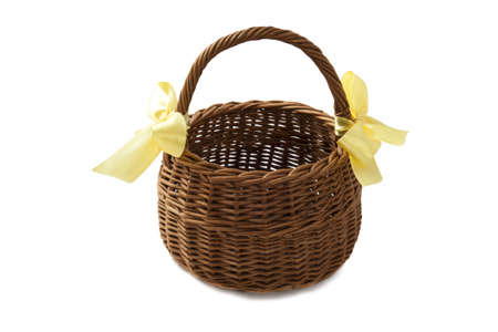 picknick: Basket with yellow knots isolated over white