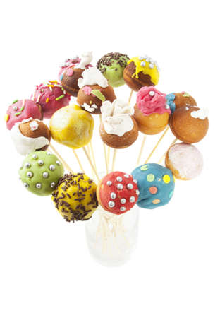 cake pops: Colorful decorated pop cakes isolated over white