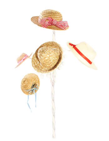 hanged woman: Straw hats hanging on a cane isolated over white Stock Photo
